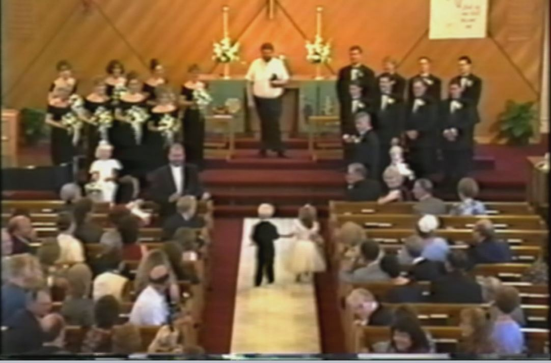 Briggs and Brittany head down the aisle for the first time in 1995 as a flower girl and page boy for the same wedding. Image: Fox 9.
