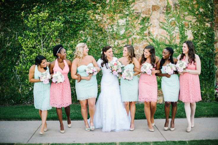 bride and bridesmaids in mint green and pink