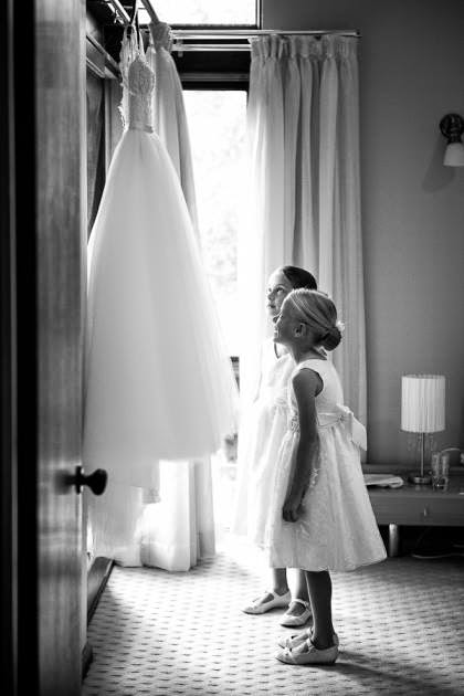 flower girls admiring the brides gown
