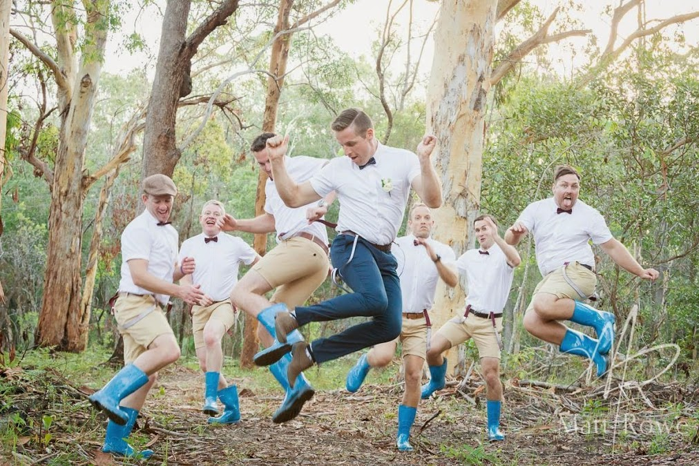 groomsmen in bright blue gumboots