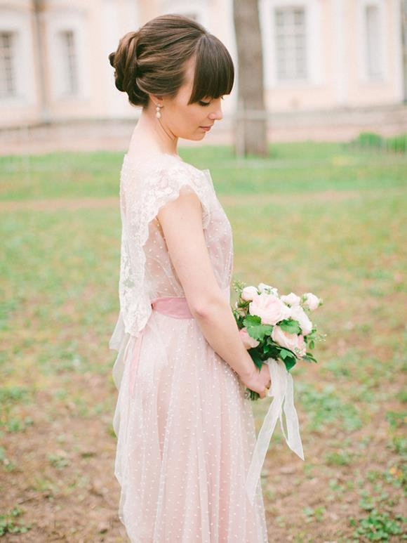 Lace wedding gown by Tanya Kochnova