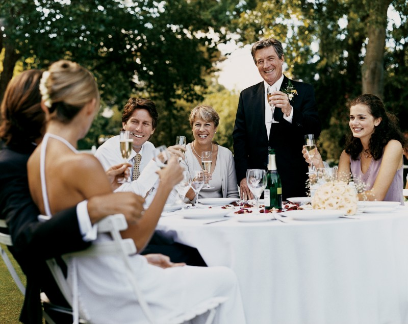 The father-of-the-bride toasts the happy couple.